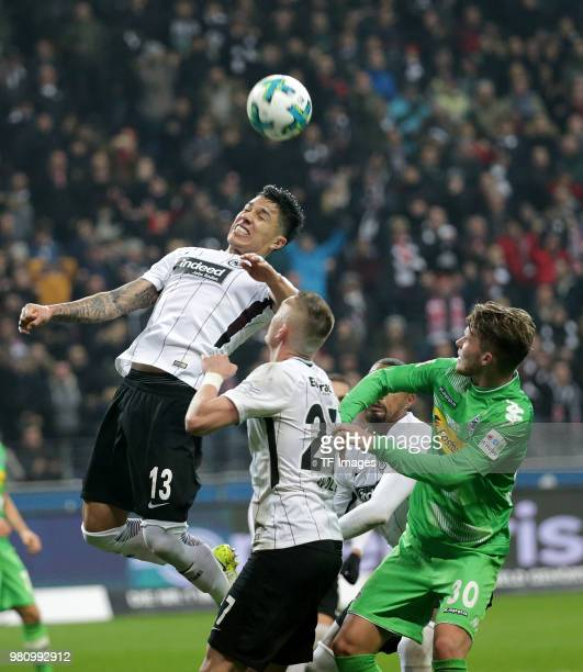 Carlos Salcedo of Frankfurt Marius Wolf of Frankfurt and Nico Elvedi of Moenchengladbach battle for the ball during the Bundesliga match between...