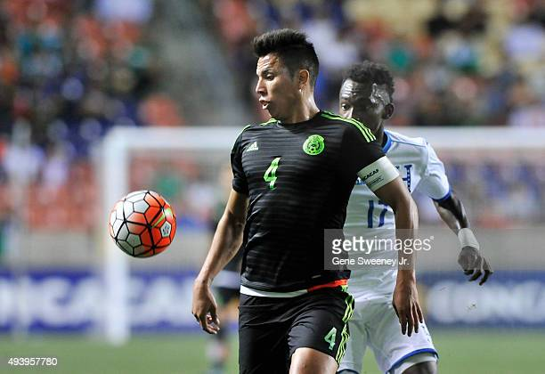 Carlos Salcedo of Mexico and Alberth Elis of Honduras eye the ball during the final CONCACAF Olympic Qualifying match at Rio Tinto Stadium on October...