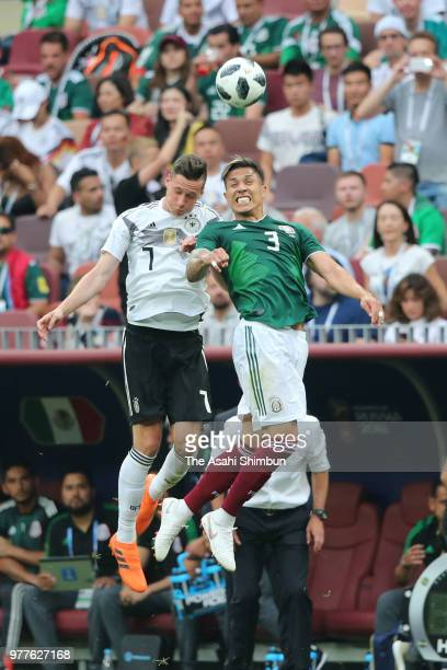 Carlos Salcedo of Mexico and Julian Draxler of Germany compete for the ball during the 2018 FIFA World Cup Russia Group F match between Germany and...