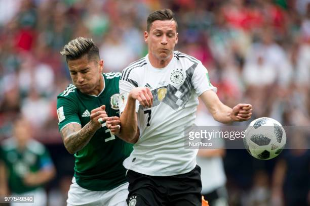 Carlos Salcedo of Mexico and Julian Draxler of Germany during the 2018 FIFA World Cup Russia Group F match between Germany and Mexico at Luzhniki...