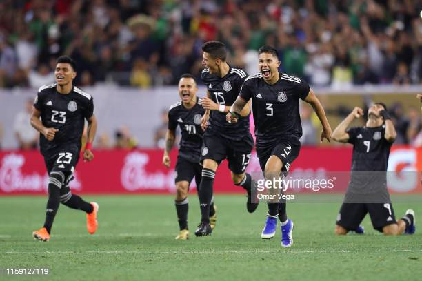 Carlos Salcedo of Mexico celebrates with his teammates their victory after a quarterfinal match between Mexico and Costa Rica as part of 2019...