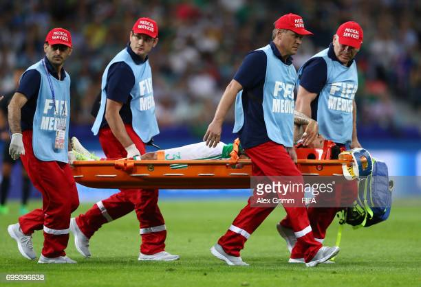 Carlos Salcedo of Mexico is stretchered off during the FIFA Confederations Cup Russia 2017 Group A match between Mexico and New Zealand at Fisht...