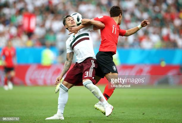 Carlos Salcedo of Mexico is tcakled by Hwang Heechan of Korea Republic during the 2018 FIFA World Cup Russia group F match between Korea Republic and...