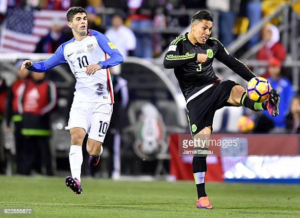 Carlos Salcedo of Mexico kicks the ball while Christian Pulisic of the United States defends in the first half during the FIFA 2018 World Cup...