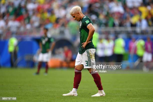 Carlos Salcedo of Mexico looks dejectd following Brazil's second goal during the 2018 FIFA World Cup Russia Round of 16 match between Brazil and...