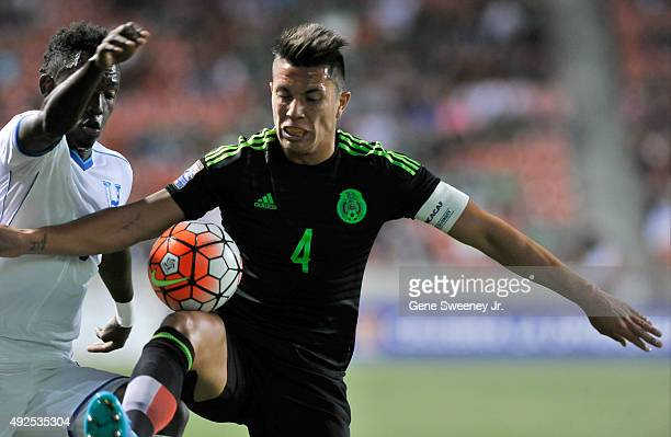 Carlos Salcedo of Mexico tries to keep the ball away from Alberth Elis of Honduras during the first half of the final CONCACAF Olympic Qualifying...