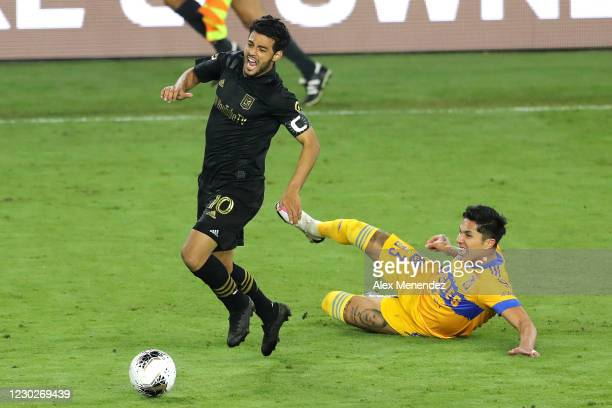 Carlos Salcedo of Tigres UANL fouls Carlos Vela of Los Angeles FC during the CONCACAF Champions League final game at Exploria Stadium on December 22,...
