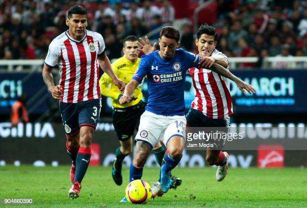 Carlos Salcido and Jesus Sanchez of Chivas fight for the ball with Martin Rodriguez of Cruz Azul during the 2nd round match between Chivas and Cruz...