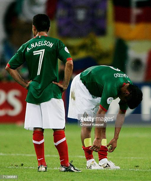 Carlos Salcido and Zinha of Mexico show their dejection at the end of the FIFA World Cup Germany 2006 Round of 16 match between Argentina and Mexico...