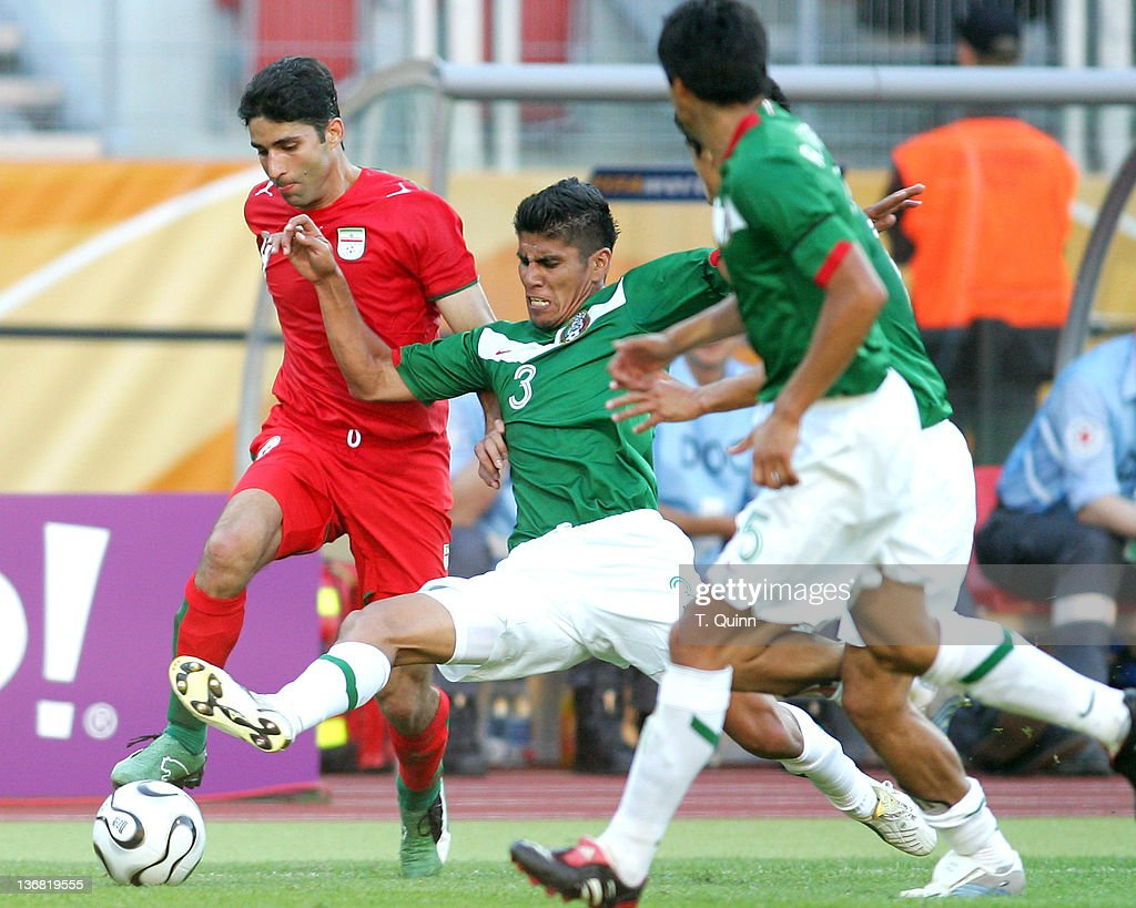 Carlos Salcido crashes against Yahya Golmohammadi of Iran in sold-out Franken stadium, Nuremberg, Germany on June 11, 2006. Mexico stunned Iran for a 3-1 victory.