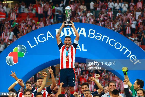 Carlos Salcido of Chivas lifts the champions trophy after winning the Final second leg match between Chivas and Tigres UANL as part of the Torneo...