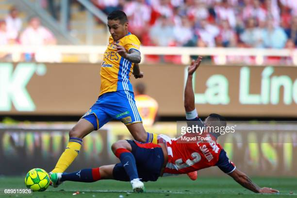 Carlos Salcido of Chivas slides for the ball as Ismael Sosa of Tigres tries to dribble during the Final second leg match between Chivas and Tigres...