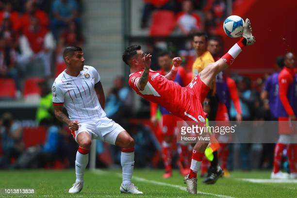 Carlos Salcido of Chivas struggles for the ball with Rubens Sambueza of Toluca during the third round match between Toluca and Chivas as part of the...