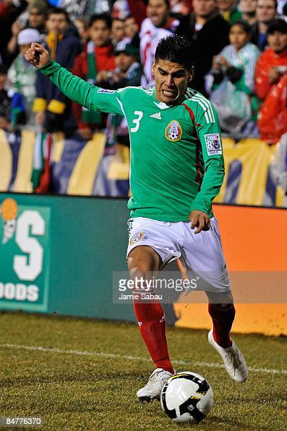 Carlos Salcido of Mexico dribbles the ball against USA during a FIFA 2010 World Cup qualifying match in the CONCACAF region on February 11 2009 at...