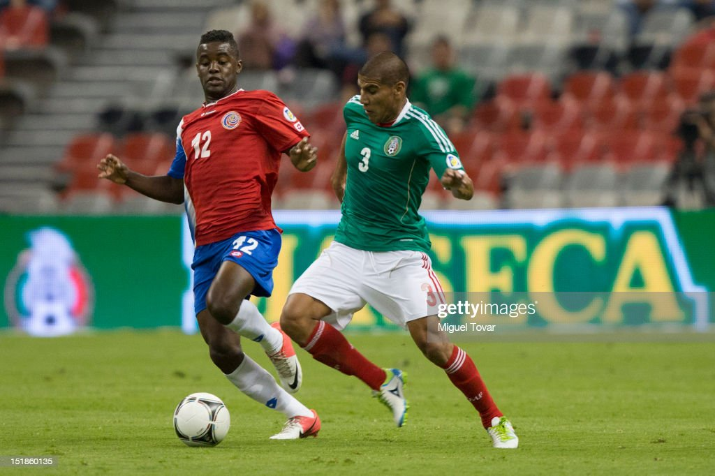Carlos Salcido of Mexico figths for the ball with Joel Campbell of Costa Rica during a match between Mexico and Costa Rica as part of the CONCACAF Qualifiers at the Estadio Azteca on September 11, 2012 in Mexico City, Mexico.