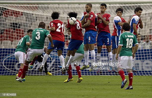 Carlos Salcido of Mexico kicks the ball off a free kick during their Brazil 2014 FIFA World Cup Concacaf qualifier match against Cost Rica at the...