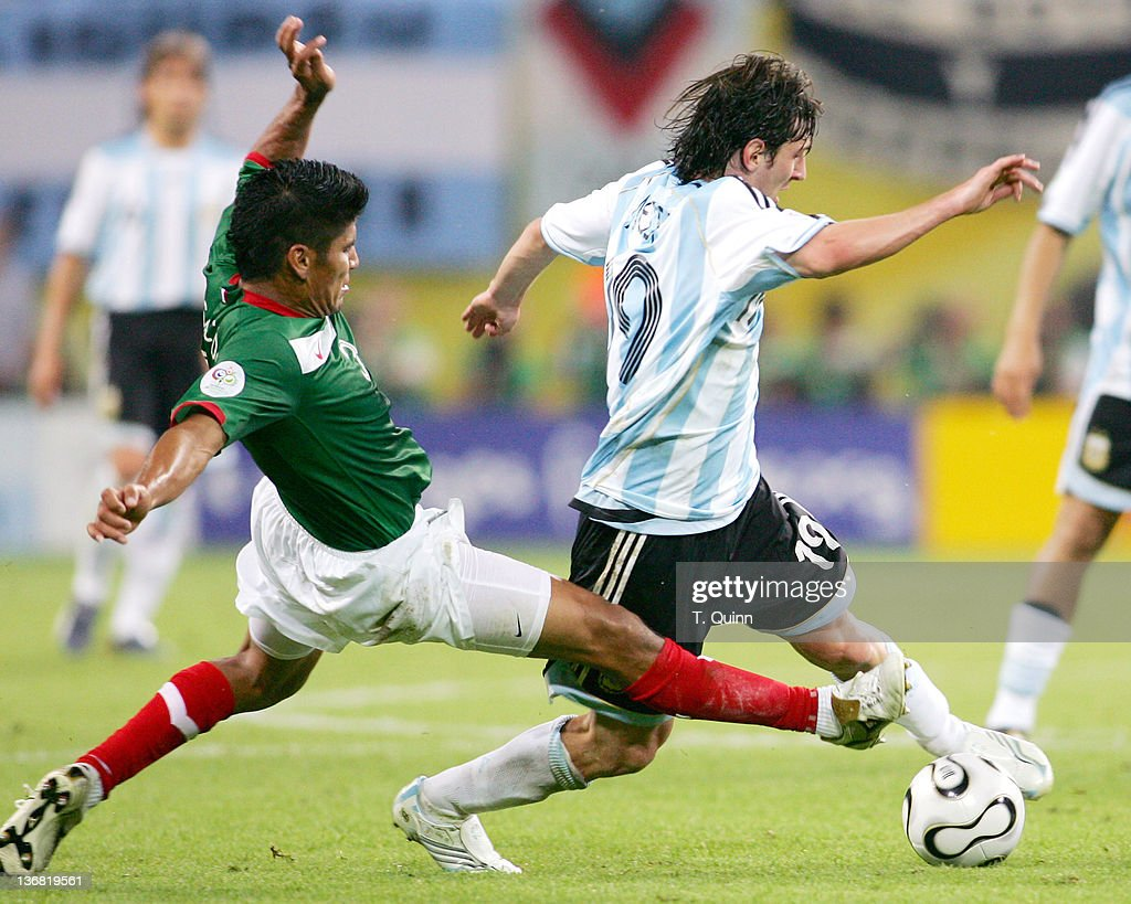 Carlos Salcido of Mexico slides in from the back to tackle Hernan Crespo of Argentina during the Round of 16 match at Zentralstadion in Leipzig, Germany on June 24, 2006. Argentina needed extra time to defeat Mexico 2-1.