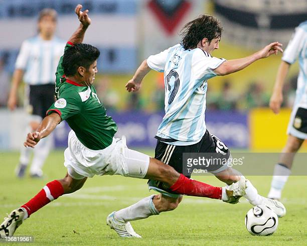 Carlos Salcido of Mexico slides in from the back to tackle Hernan Crespo of Argentina during the Round of 16 match at Zentralstadion in Leipzig...