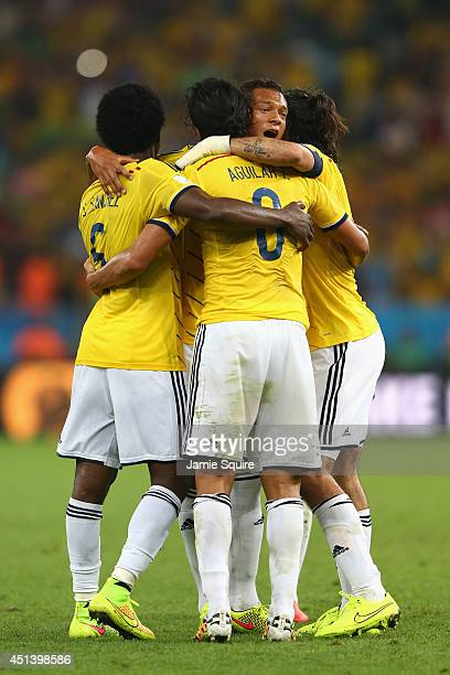 Carlos Sanchez Abel Aguilar Fredy Guarin and Mario Yepes of Colombia celebrate after defeating Uruguay 20 during the 2014 FIFA World Cup Brazil round...