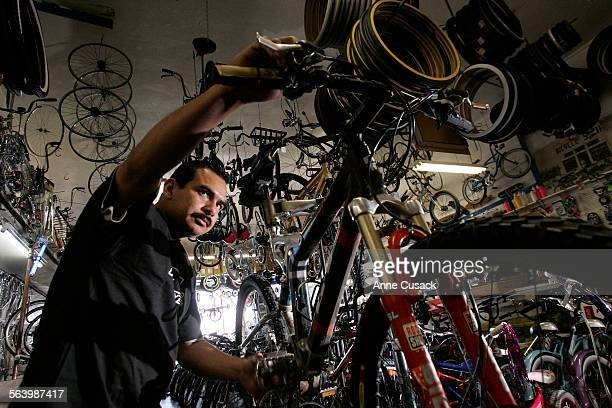 Carlos Sanchez adjusts the brakes in Dennison Cyclery on Whittier Boulevard May 13 2008 in East Los Angeles The shop has been in business since 1941...