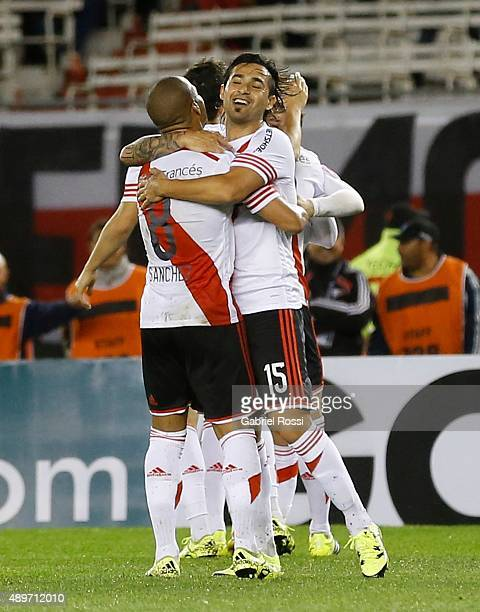Carlos Sanchez and Leonardo Pisculichi of River Plate celebrate their team's first goal during a first leg match between River Plate and Liga...