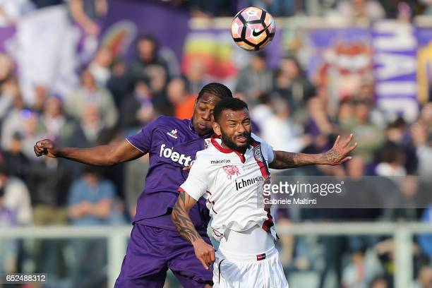 Carlos Sanchez of ACF Fiorentina battles for the ball with Joao Pedro of Cagliari Calcio during the Serie A match between ACF Fiorentina and Cagliari...