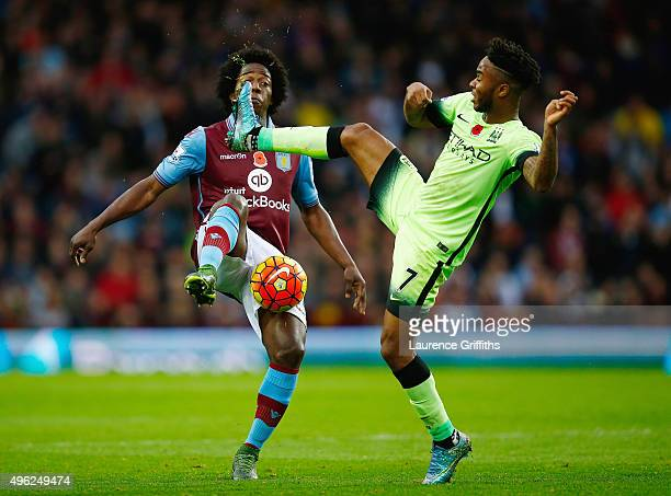 Carlos Sanchez of Aston Villa and Raheem Sterling of Manchester City compete for the ball during the Barclays Premier League match between Aston...