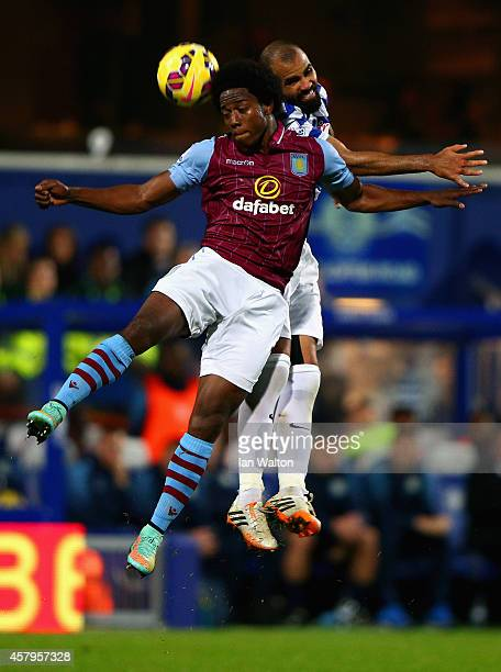 Carlos Sanchez of Aston Villa and Sandro of QPR compete for the header during the Barclays Premier League match between Queens Park Rangers and Aston...