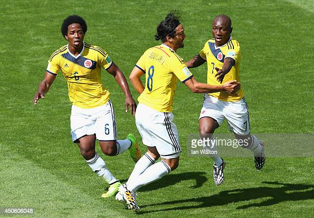 Carlos Sanchez of Colombia Abel Aguilar and Pablo Armero celebrate after Armero scored the first goal during the 2014 FIFA World Cup Brazil Group C...