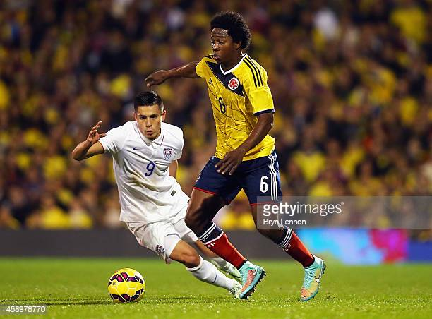 Carlos Sanchez of Colombia avoids Rubio Rubin of the USA during the International Friendly between the USA and Colombia at Craven Cottage on November...
