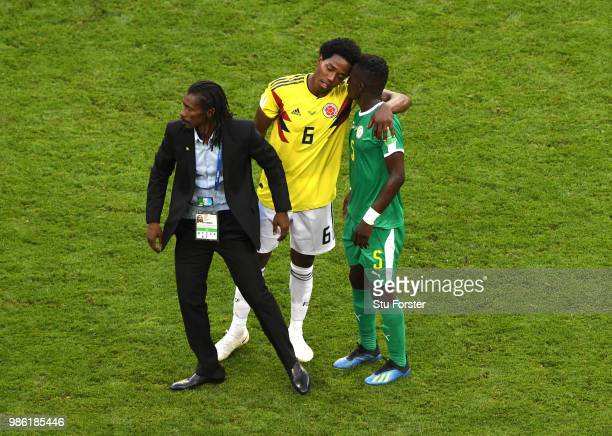 Carlos Sanchez of Colombia consoles Idrissa Gana Gueye of Senegal following Colombia's victory in the 2018 FIFA World Cup Russia group H match...