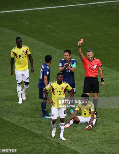 Carlos Sanchez of Colombia is sent off by Referee Damir Skomina during the 2018 FIFA World Cup Russia group H match between Colombia and Japan at...