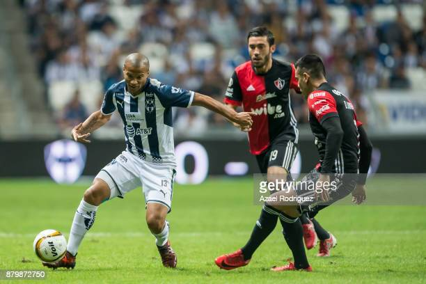 Carlos Sanchez of Monterrey fights for the ball with Daniel Arreola of Atlas during the quarter finals second leg match between Tigres UANL and Leon...