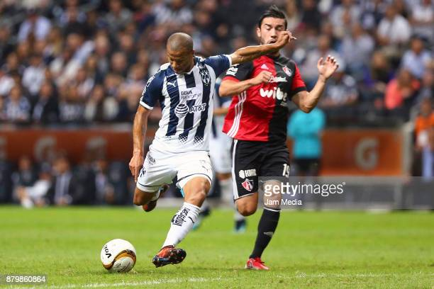 Carlos Sanchez of Monterrey fights for the ball with Juan Pablo Vigon of Atlas during the quarter finals second leg match between Monterrey and Atlas...