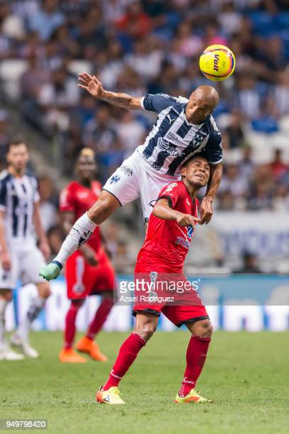 Carlos Sanchez of Monterrey heads the ball with Juan Carlos Medina of Lobos during the 16th round match between Monterrey and Lobos BUAP as part of...