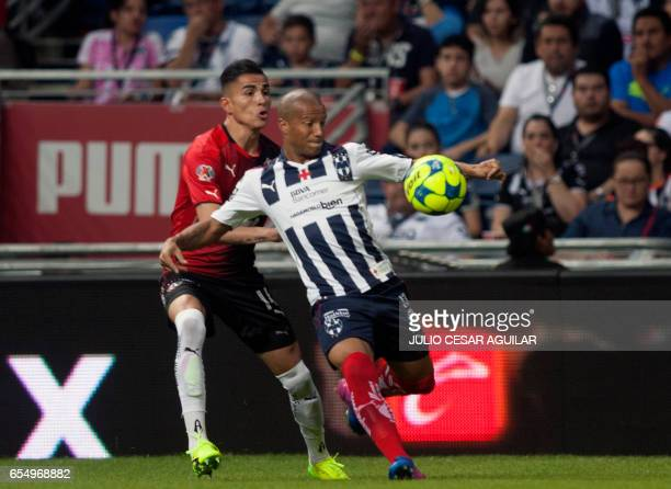 Carlos Sanchez of Monterrey vies for the ball with Luis Reyes of Atlas during their Mexican Clausura 2017 tournament football match at the BBVA...
