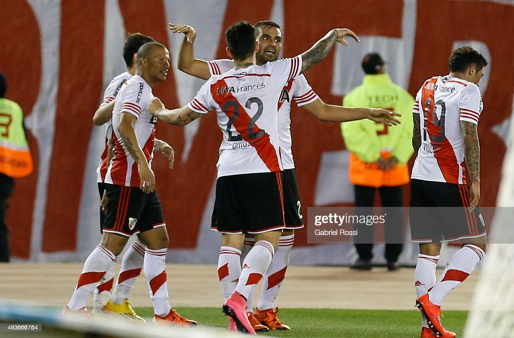 Carlos Sanchez of River Plate and teammates celebrate their team's third goal during a match between River Plate and Chapecoense as part of Quarter Finals of Copa Sudamericana 2015 at Monumental Antonio Vespucio Liberti Stadium on October 21, 2015 in Buenos Aires, Argentina.