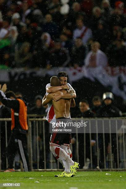 Carlos Sanchez of River Plate celebrates with Fernando Cavenaghi of River Plate after scoring the second goal of his team through a penalty kick...