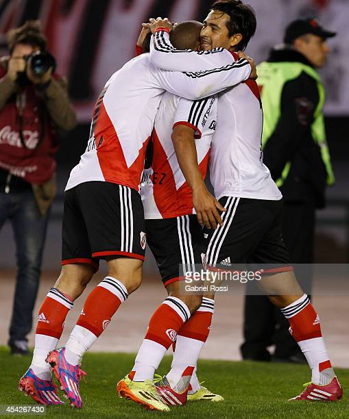 Carlos Sanchez of River Plate celebrates with his teammates after scoring the first goal during a match between River Plate and Defensa y Justicia as...
