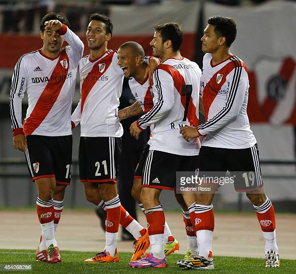 Carlos Sanchez of River Plate celebrates with his teammates after scoring the second goal of his team during a match between River Plate and Defensa...