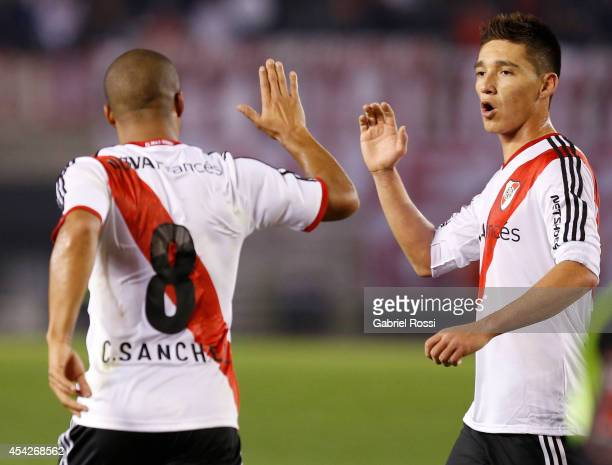 Carlos Sanchez of River Plate celebrates with his teammates after scoring the first goal of his team during a match between River Plate and Defensa y...