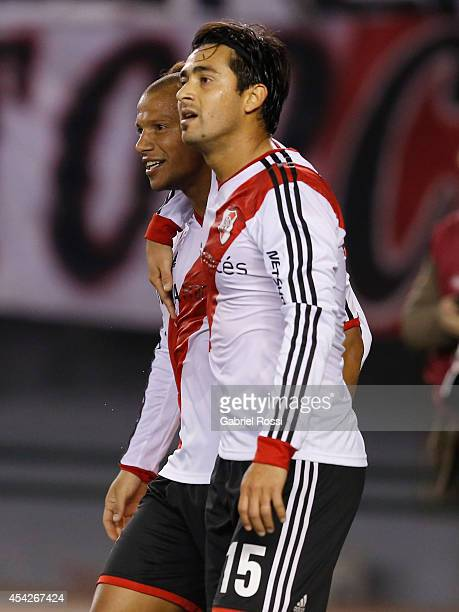 Carlos Sanchez of River Plate celebrates with Leonardo Pisculichi after scoring the first goal of his team during a match between River Plate and...