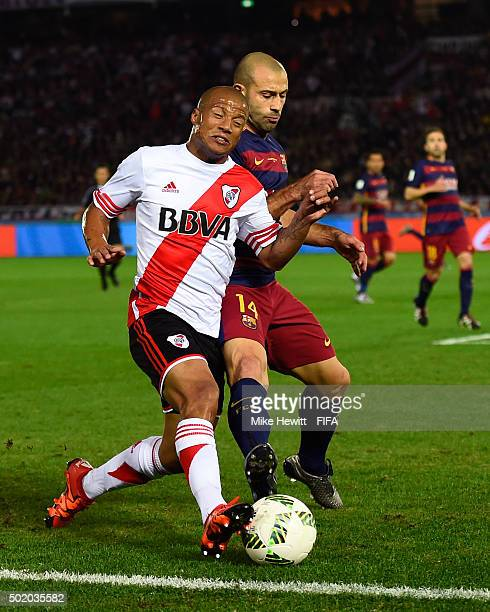 Carlos Sanchez of River Plate is challenged by Javier Mascherano of Barcelona during the FIFA Club World Cup Final between River Plate and FC...