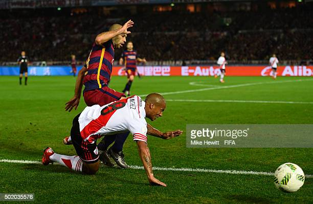 Carlos Sanchez of River Plate is fouled by Javier Mascherano of Barcelona during the FIFA Club World Cup Final between River Plate and FC Barcelona...
