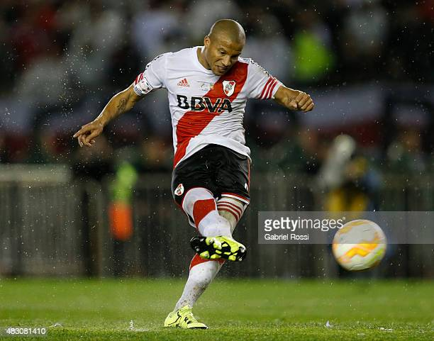 Carlos Sanchez of River Plate shoots to score the second goal of his team through a penalty kick during a second leg final match between River Plate...