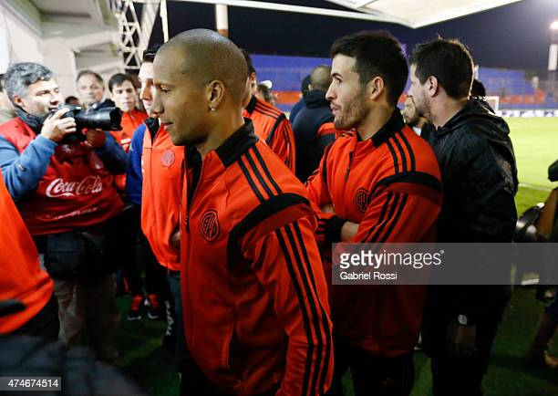 Carlos Sanchez of River Plate walks to the locker room with his teammates after receiving the confirmation of the Tigre v River Plate match...