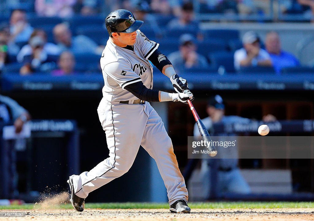 Carlos Sanchez #77 of the Chicago White Sox connects on a tenth inning base hit against the New York Yankees at Yankee Stadium on August 24, 2014 in the Bronx borough of New York City. The Yankees defeated the White Sox 7-4 in ten innings.