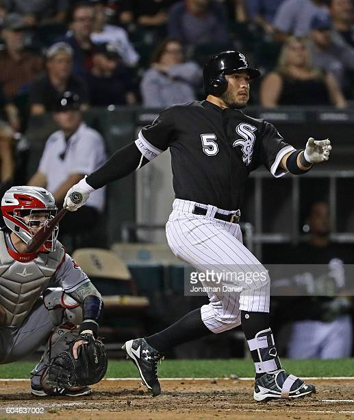 Carlos Sanchez of the Chicago White Sox hits a two run triple in the 6th innning against the Cleveland Indians at US Cellular Field on September 13...