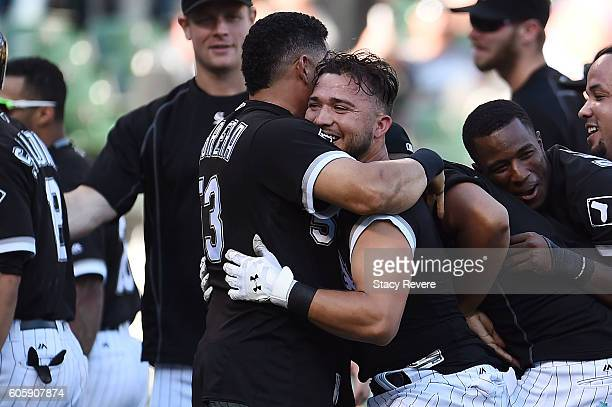 Carlos Sanchez of the Chicago White Sox is embraced by Melky Cabrera after driving in the winning run in the ninth inning of a game against the...