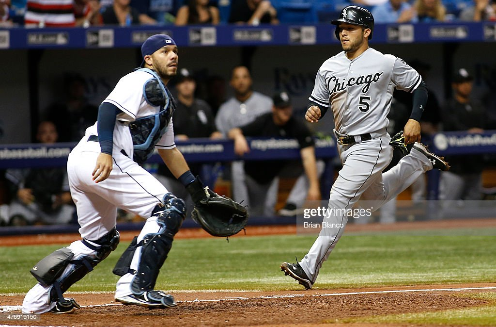 Carlos Sanchez #5 of the Chicago White Sox runs in to score off of a throwing error by Rene Rivera #44 of the Tampa Bay Rays following the bunt single by Adam Eaton #1 during the fifth inning of a game on June 12, 2015 at Tropicana Field in St. Petersburg, Florida.
